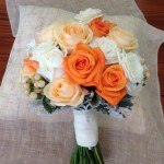 Peaches and Tangerines: Roses and Hypericum Berries with Dusty Miller foliage