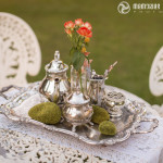 Vintage tea set with simple blooms and moss stones
