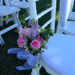 Garden picked style posies for ceremony chairs