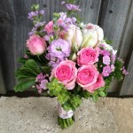 Spring garden themed bouquet: Parrot Tulips, Clustar Roses, Sweet William, Stocks and Succulants