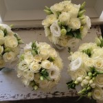 Seasonal green and white bouquets.