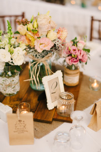 Seasonal mixed blooms in jars   Styling by Wedding Day Flair Photography by Jason Tey Photography